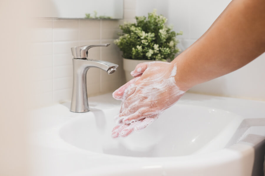 Closeup of a someone washing their hands to prevent the spread of COVID-19 in Flower Mound, TX